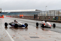 A wet early morning pit lane